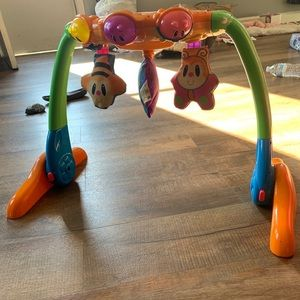 Infant lay under toy